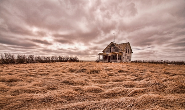 "Nikon D90, lens unknown, ISO 400, f4.8, 1/4000s, tripod. ""Sea of Life"" :by Bill Kruse: "" The homestead with the barn already fallen to earth and reclaimed by the land; the lonesome home sits in a rough sea of grass calling out for its next life."""