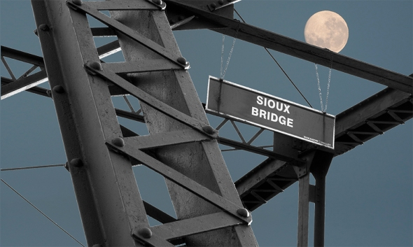 "Nikon D90. lens unknown, ISO 200, f5.6, 1/500s. Sioux Bridge by Bill Kruse: ""This is a 3 shots in one image - Bridge, Sky, Moon."""