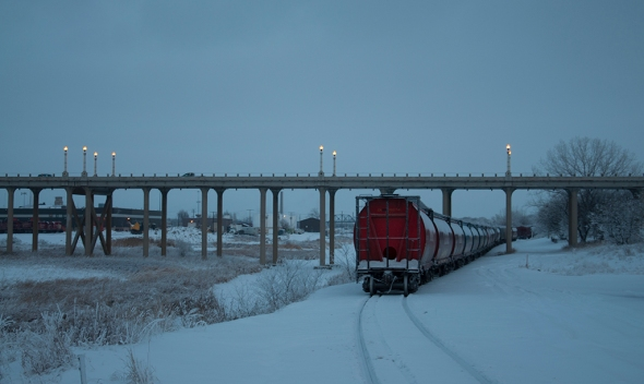 "Nikon D90, lens unknown, ISO 200, f4.8, 1/60s. ""Winter Train"" by Bill Kruse: ""This is my best shot so far as there are lots of stories in this pic. When i show this at my trade shows there is always someone with a story around this subject matter. Ii took the shot because of the rail cars and the bridge."""